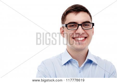 Front portrait of young smiling man wearing black glasses and blue formal shirt with open collar isolated on white background - business concept