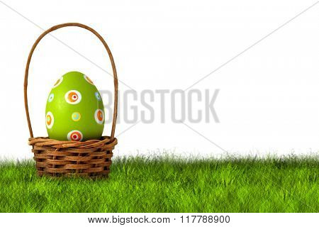 Basket for Easter Egg hunt on grass on white background