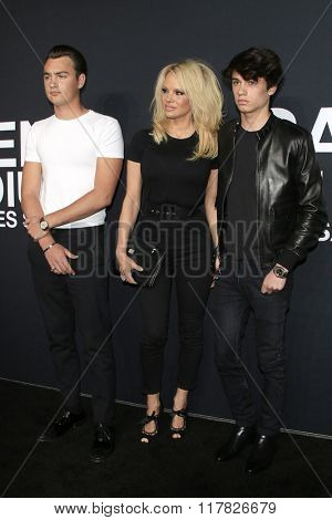 LOS ANGELES - FEB 10: Brandon Lee, Pamela Anderson, Dylan Lee arriving at the Saint Laurent fashion show at the Hollywood Palladium on February 10, 2016 in Los Angeles, California