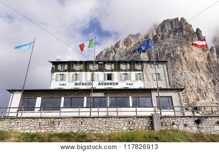 DOLOMITES, ITALY - September 15, 2015: Alpine hut Refugio Auronzo in Dolomites, Italy. With an elevation of 2333m, it is a landmark stop for climbing the peaks of Dolomites Alps.
