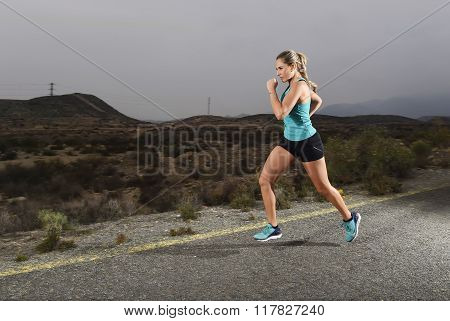 Young Fit Sport Woman Running Outdoors On Asphalt Road In Mountain Fitness Workout