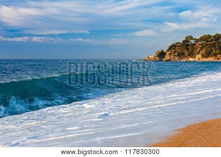 Sea waves and sand main beach at popular holiday resort Lloret de Mar on Costa Brava in the morning , Catalunya, Spain poster
