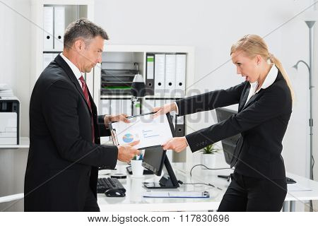 Business People Snatching Project In Office