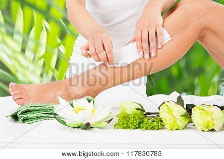 Woman Getting Legs Waxed