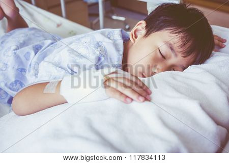 Asian Boy Sleeping On Sickbed, Saline Intravenous (iv) On Hand.