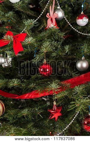 Close up of natural green Christmas tree with decorations