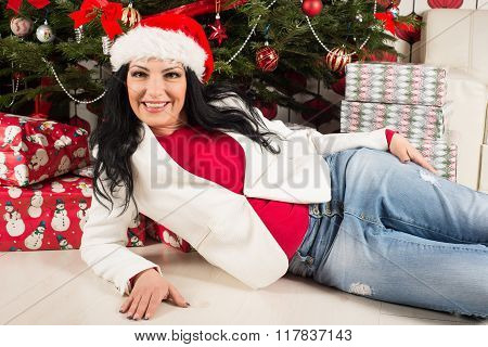 Happy  Woman Lying In Front Of Xmas Tree