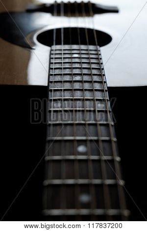 Closeup detail of guitar strings for playing music instrument talent strum strumming