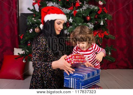 Mom And Toddler Opening Christmas Presents