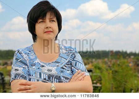 Portrait Of Brunette Plumpy Serious Woman, Crossed Hands