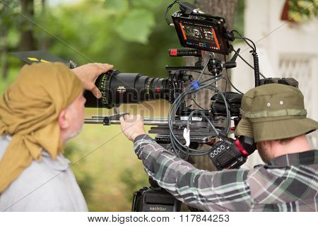 RUSSIA, MOSCOW -?? 30 JUL, 2015: Men are shooting movie (Maximum shock) with professional digital video camera in the Sokolniki park.