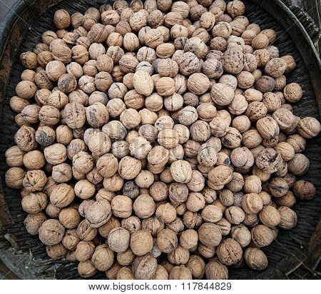 Basket of walnuts on the market square.