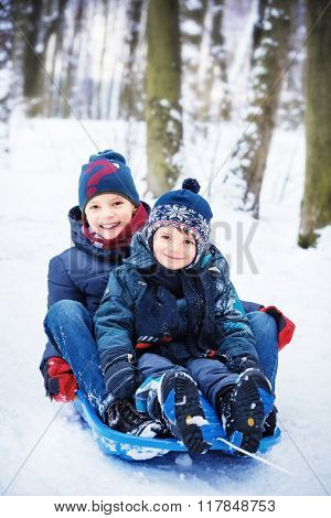 two brothers on sled