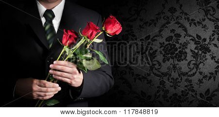 Valentine's day. Man holding red roses. Banner. Space for text.