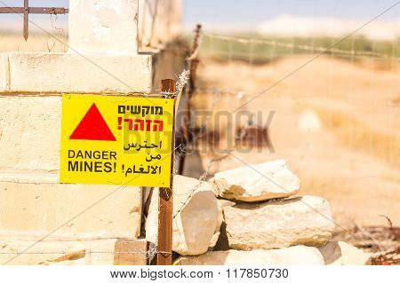 Danger Mines! Warning Sign And Barbed Wire.