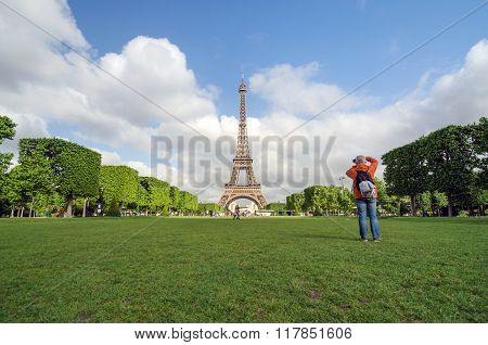 Paris, France - May 15, 2015: People Visit The Champs De Mars, At The Foot Of The Eiffel Tower