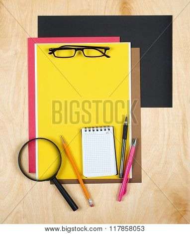 Flat lay office tools and supplies. Education background with stationery on wood. Flat design of creative office workspace, workplace. Top view of desk background.