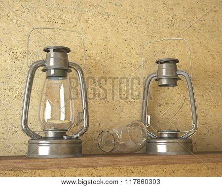 two oil lamps stand on a shelf