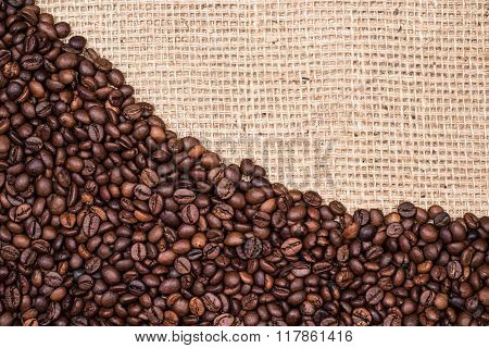 Coffee bean background with gunny textile
