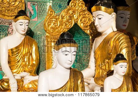 Close Up Of Different Sized Golden Buddhas At The Shwedagon Pagoda