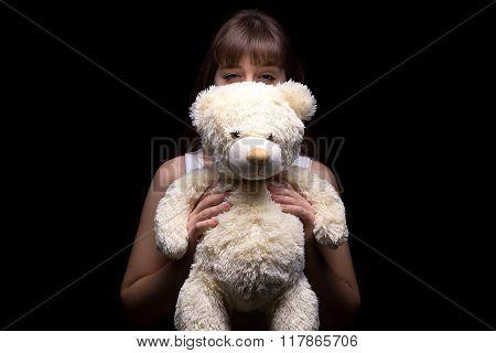 Cunning teenage girl with teddy bear