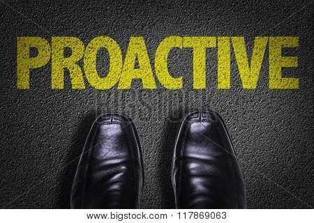 Top View of Business Shoes on the floor with the text: Proactive