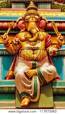 Statue of Lord Ganesha at the entrance gopuram of Shiva temple