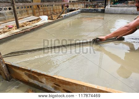 Photo Of Plasterer Concrete Worker At Floor Work