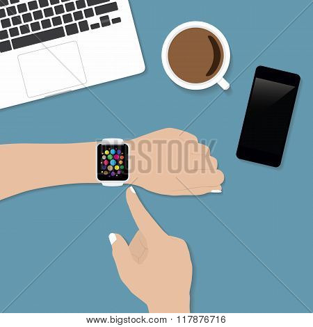 Hand Using Smart Watch On Desk