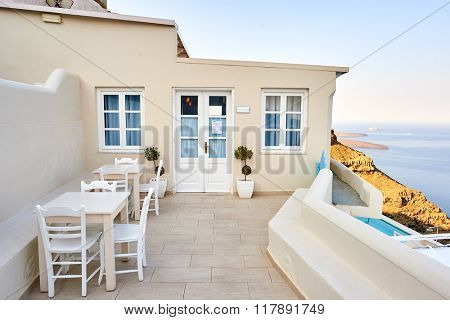SANTORINI, GREECE - AUGUST 05, 2015: view of Andromeda Villas at morning. Andromeda Villas is an elegant hotel are situated in Imerovigli, Santorini island.