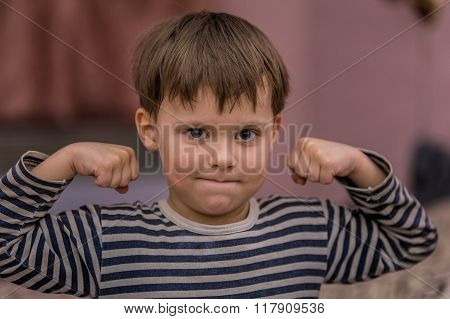 Portrait Of A Strong Little Boy.