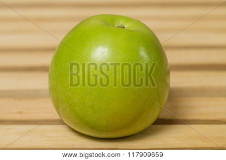 Green Round Apple On The Table.