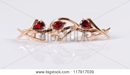 Set Of Gold Earrings And Ring With Ruby