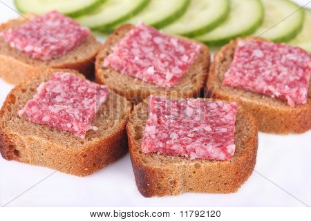 Sandwiches with sausage and rye bread with cucumber