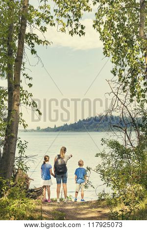 Family on a day hike together near a beautiful mountain lake