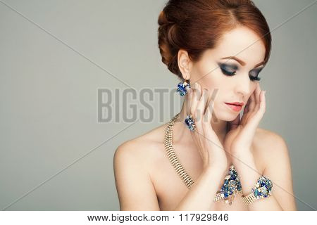 Beautiful woman with evening make-up. Jewelry and Beauty. Fashion photo