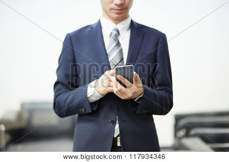 Man with smart phone on hand