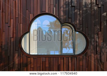 Evening Facade Of A Modern Building With Window Like A Cloud