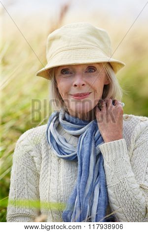 Head And Shoulders Portrait Of Senior Woman On Walk