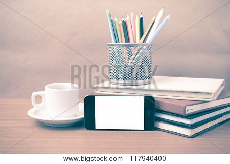 coffee phone stack of book and coluor pencil on wood table background