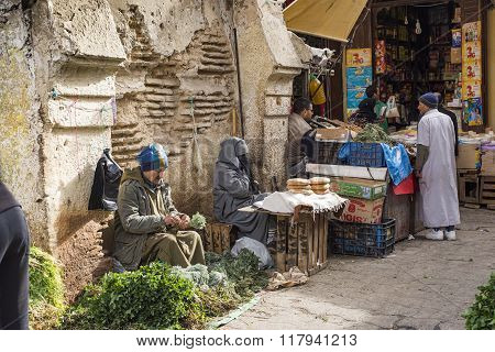 Man Selling Typical Arabian Aromatic Herbs In A Street Of Morocco.