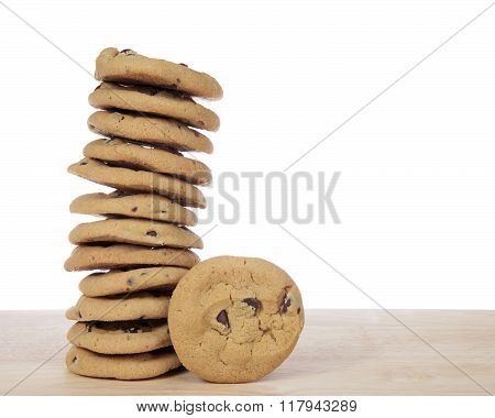 Stack Of 12 Chocolate Chip Cookies With One Cookie Next To It