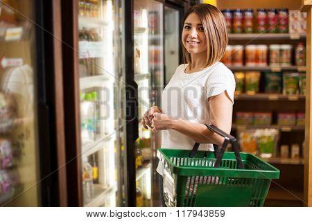 Cute Latin Woman At A Supermarket