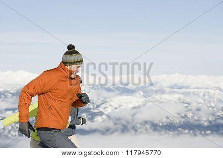 Skiers running