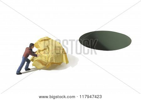 Man Pushing Paper Wad Into Hole
