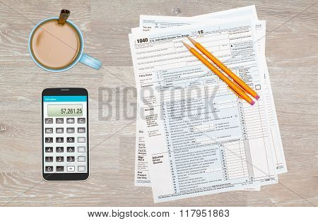 Coffee And Calculator On 2015 Irs Form 1040