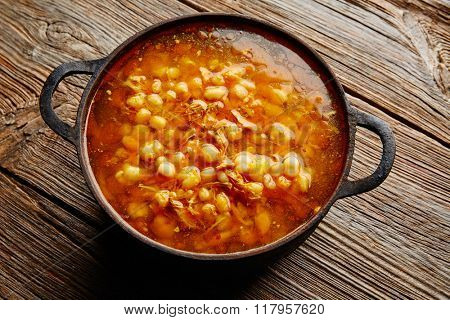 Pozole with mote big corn stew from Mexico in old cooking pot