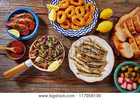 Tapas mix spanish clams olives shrimps calamari romana and fried anchovies fish
