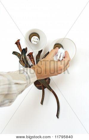 Changing light bulb