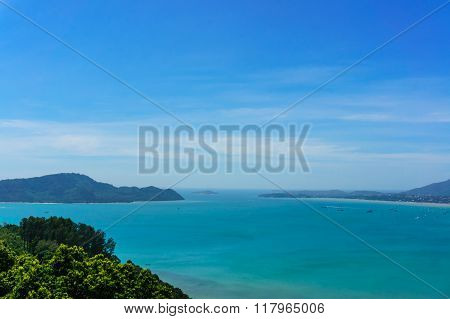 Coast of Phuket. Thailand Tree in front view and background with moutain